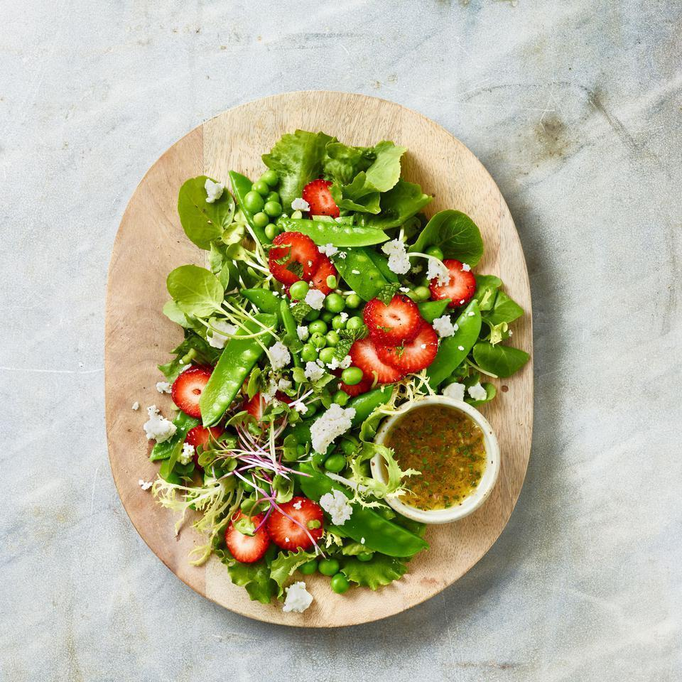 """<p>As delicious as it is beautiful, this spring pea salad recipe is a potluck or dinner party stunner. Assemble the salad and dress just before serving--or serve the dressing next to the salad for people to drizzle. The tangy champagne vinaigrette balances the grassy sweetness of the peas and fruity pop of the berries. <a href=""""http://www.eatingwell.com/recipe/251390/spring-pea-salad-with-strawberries/"""" rel=""""nofollow noopener"""" target=""""_blank"""" data-ylk=""""slk:View recipe"""" class=""""link rapid-noclick-resp""""> View recipe </a></p>"""