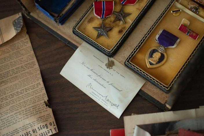 """A Purple Heart, two bronze stars and other artifacts belonging to veteran Crosby """"Bing"""" Powell were found in the garage loft of Mikell Burr's home over the Labor Day weekend. She returned those items to him Friday at his apartment in Topeka, Kansas."""