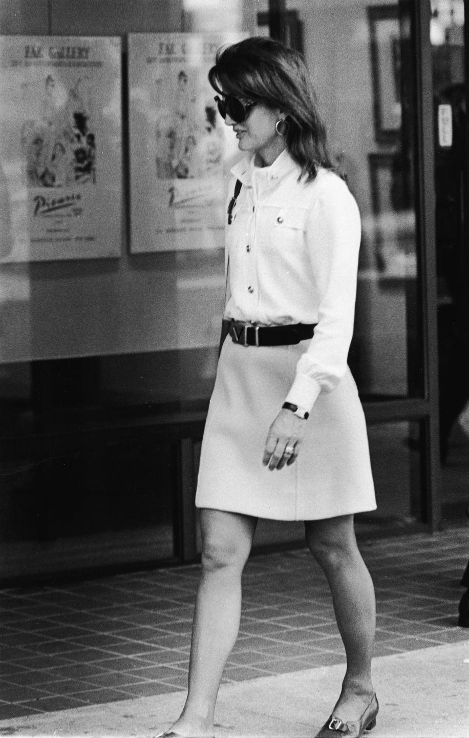 <p>An A-line skirt with a leather belt and tucked-in button-down jacket—accessorized with gold hoops and her Cartier Tank watch, of course—is a city-sleek look for running errands. <br></p>