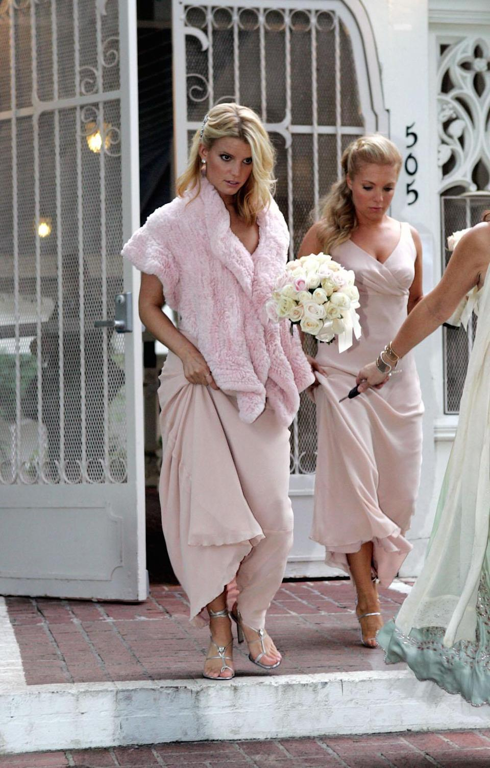 """<p><a rel=""""nofollow noopener"""" href=""""http://www.eonline.com/photos/9043/celebrity-bridesmaids/490865"""" target=""""_blank"""" data-ylk=""""slk:According to"""" class=""""link rapid-noclick-resp"""">According to </a><i>EOnline</i>, the celebrity designer and songstress has been a bridesmaid at least six times! Here she is looking pretty in pale pink. <i>(Splash News)</i></p>"""