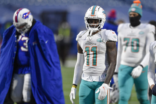Miami Dolphins wide receiver DeVante Parker (11) walks off the field after losing an NFL football game against the Buffalo Bills, Sunday, Jan. 3, 2021, in Orchard Park, N.Y. (AP Photo/Adrian Kraus)