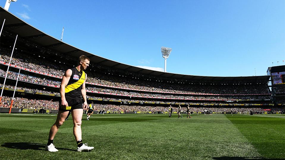Richmond player walks on the MCG turf during the AFL Grand Final.