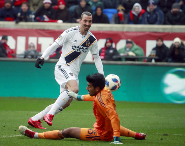 Chicago Fire goalkeeper Richard Sanchez (45), makes a save on a shot at close range by Los Angeles Galaxy forward Zlatan Ibrahimovic (9), during the first half of an MLS soccer match in Bridgeview, Ill., on Saturday, April 14, 2018. (Nuccio DiNuzzo/Chicago Tribune via AP)