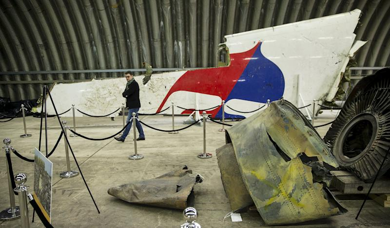 Wreckage of the MH17 airplane is seen after the presentation of the final report into the crash of July 2014 of Malaysia Airlines flight MH17 over Ukraine, in Gilze Rijen, the Netherlands