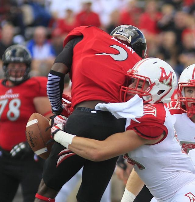 Miami (Ohio) safety Jay Mastin, right, tackles Cincinnati wide receiver Mekale McKay (2) in the first half of an NCAA college football game, Saturday, Sept. 21, 2013, in Oxford, Ohio. (AP Photo/Tony Tribble)