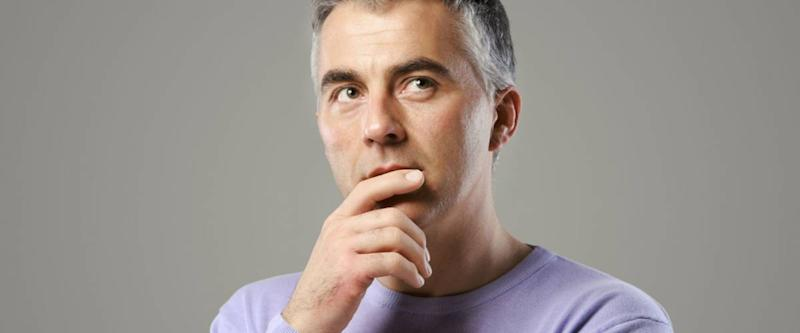 Portrait of casual man thinking and looking up