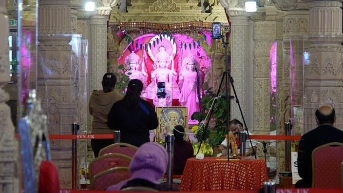 Worshippers at the Shri Vallabh Nidhi Temple in Wembley