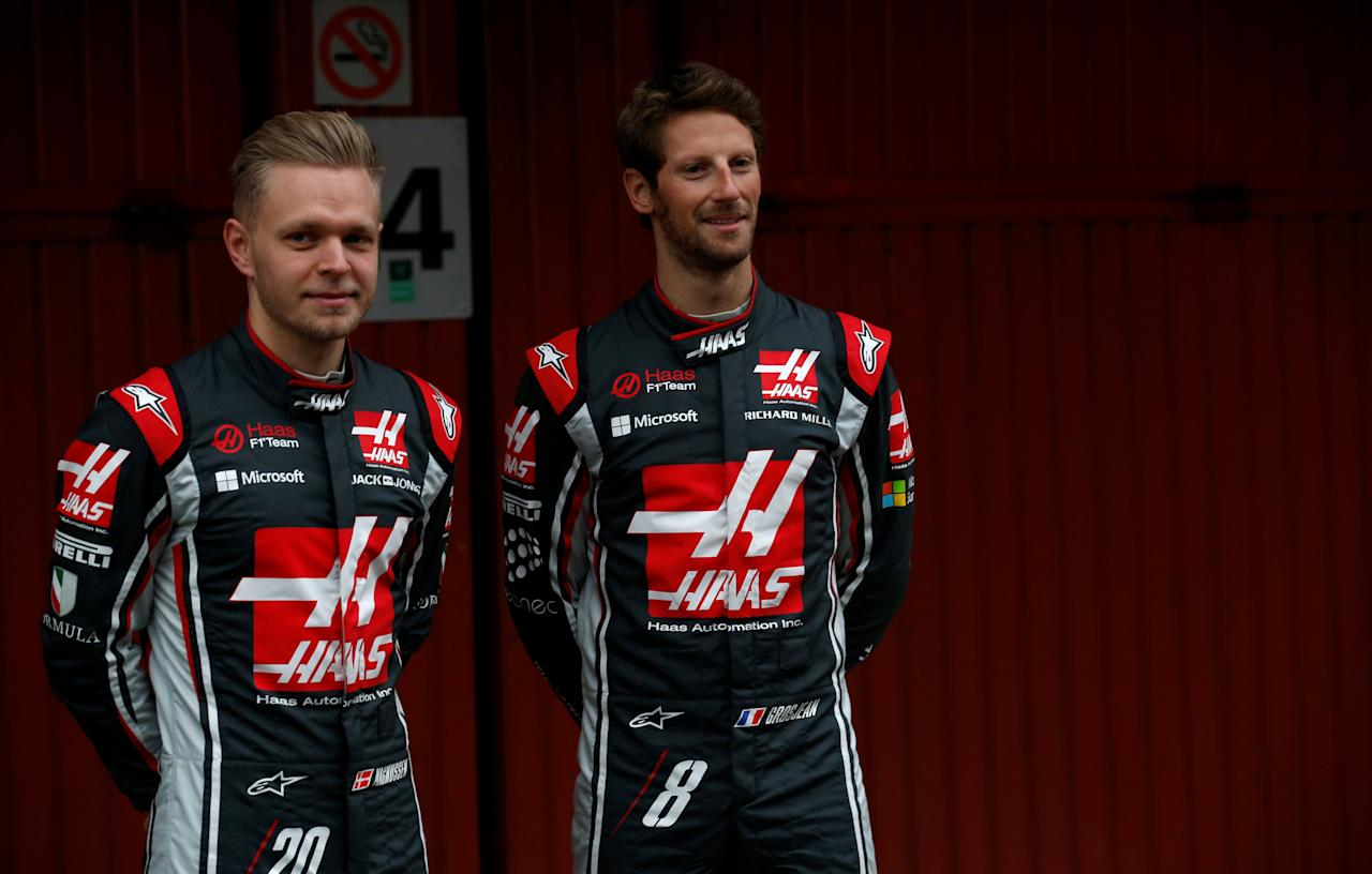 Spain Formula One - F1 - 2017 Haas VF-17 Formula One Car Launch - Barcelona-Catalunya racetrack in Montmelo - 27/2/17. Haas's drivers Romain Grosjean (R) and Kevin Magnussen pose during the presentation of the new VF-17 racing car. REUTERS/Albert Gea