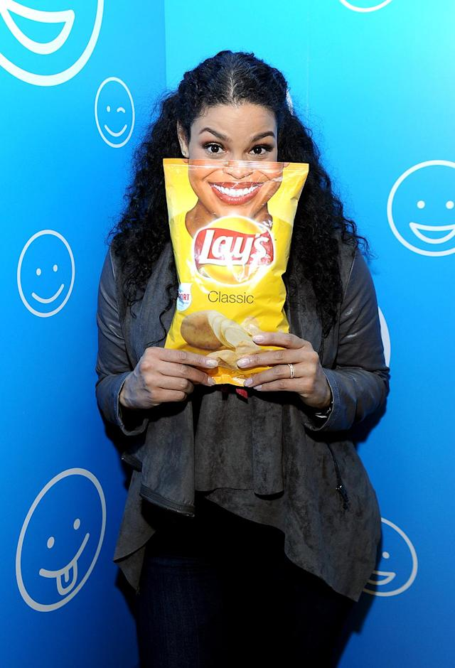Jordin Sparks holds up a specially designed Lay's bag. (Photo: Diane Bondareff/AP Images for Lays)