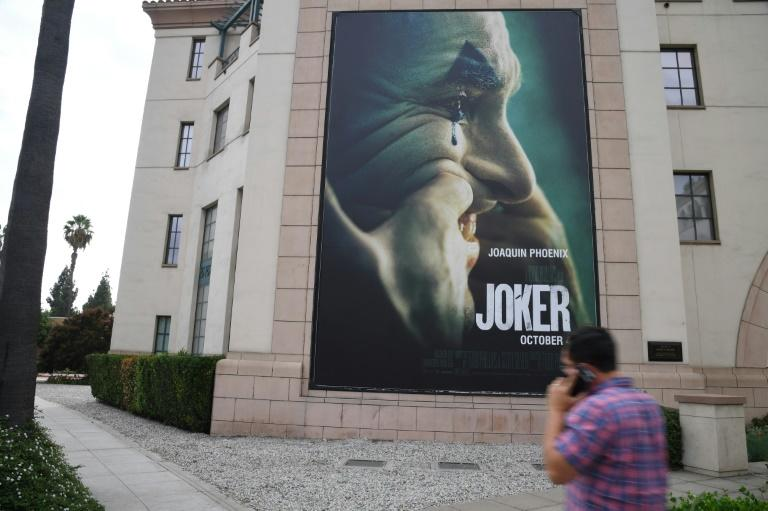 "A poster for the upcoming film ""Joker"" is seen outside Warner Brothers Studios in Burbank, California"