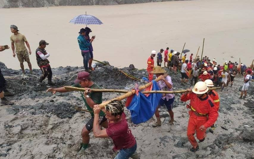 People retrieved dead bodies from the site of the accident - MYANMAR FIRE SERVICES DEPARTMENT/via REUTERS