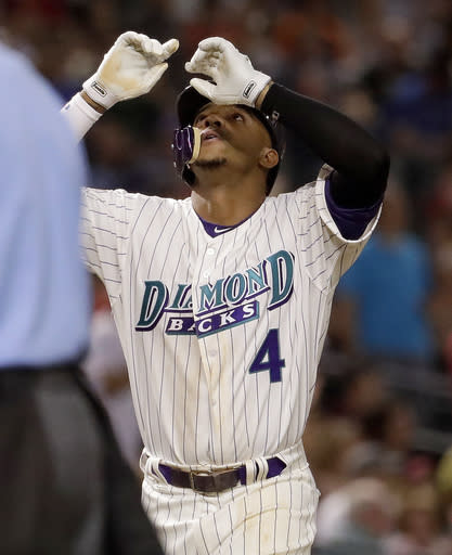 Arizona Diamondbacks Ketel Marte (4) celebrates his solo home run against the San Francisco Giants during the seventh inning of a baseball game Thursday, April 19, 2018, in Phoenix. (AP Photo/Matt York)
