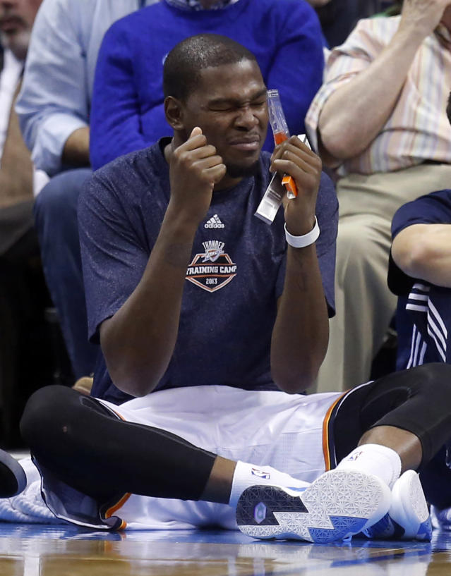 Oklahoma City Thunder forward Kevin Durant makes a face as he watches the game from the sidelines in the third quarter of a preseason NBA basketball game against the Utah Jazz in Oklahoma City, Sunday, Oct. 20, 2013. Oklahoma City won 88-82. (AP Photo/Sue Ogrocki)
