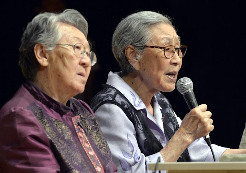FILE - In this May 25, 2013 file photo, South Korean former sex slaves Kim Bok-dong, right, and Kil Won-ok, left, attend a meeting in Osaka, western Japan. More than 70 years ago, at age 14, Kim Bok-dong was ordered to work by Korea's Japanese occupiers. She was told she was going to a military uniform factory, but ended up at a Japanese-military-run brothel in southern China. (AP Photo/Kyodo News, File) JAPAN OUT, MANDATORY CREDIT