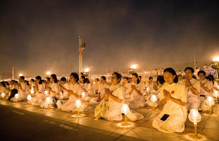"""<span class=""""caption"""">Most religions emphasize rest and contemplation.</span> <span class=""""attribution""""><a class=""""link rapid-noclick-resp"""" href=""""https://www.gettyimages.com/detail/news-photo/devotees-seen-meditating-with-their-lanterns-during-the-news-photo/1125915288?adppopup=true"""" rel=""""nofollow noopener"""" target=""""_blank"""" data-ylk=""""slk:Geovien So/SOPA Images/LightRocket via Getty Images"""">Geovien So/SOPA Images/LightRocket via Getty Images</a></span>"""