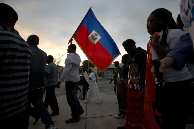 <p>Haitian-Americans carry Haitian flags and signs as they march to commemorate the eighth anniversary of the Haitian earthquake, Friday, Jan. 12, 2018, in Miami, Fla. (Photo: Wilfredo Lee/AP) </p>