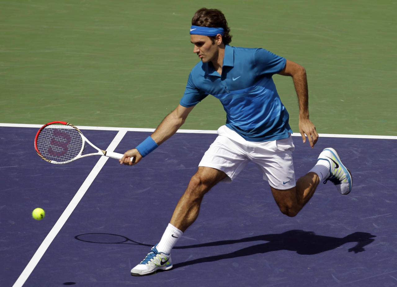 Roger Federer, of Switzerland, returns a shot to Juan Martin Del Potro, of Argentina, during a match at the BNP Paribas Open tennis tournament, Friday, March 16, 2012, in Indian Wells, Calif. (AP Photo/Darron Cummings)