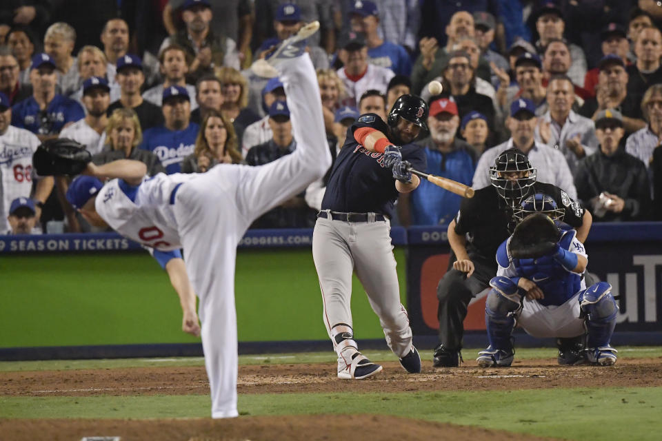 Boston Red Sox's Mitch Moreland hits a three-run home run off Los Angeles Dodgers relief pitcher Ryan Madson during the seventh inning in Game 4 of the World Series baseball game on Saturday, Oct. 27, 2018, in Los Angeles. (AP Photo/Mark J. Terrill)
