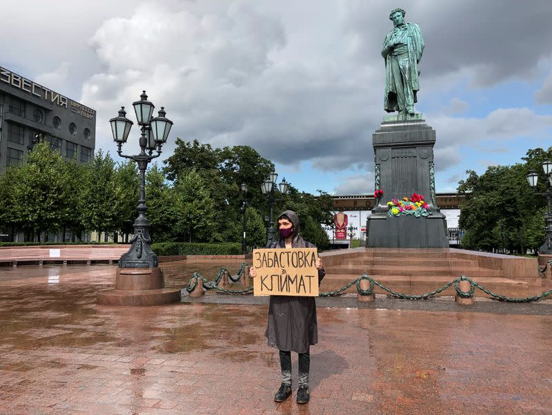 Climate activist Arshak Makichyan takes part in a single-person demonstration in Moscow