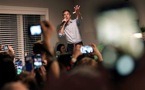 The 2020 presidential candidate gesticulates enthusiastically as he speaks to a crowd in Iowa - Credit: Reuters