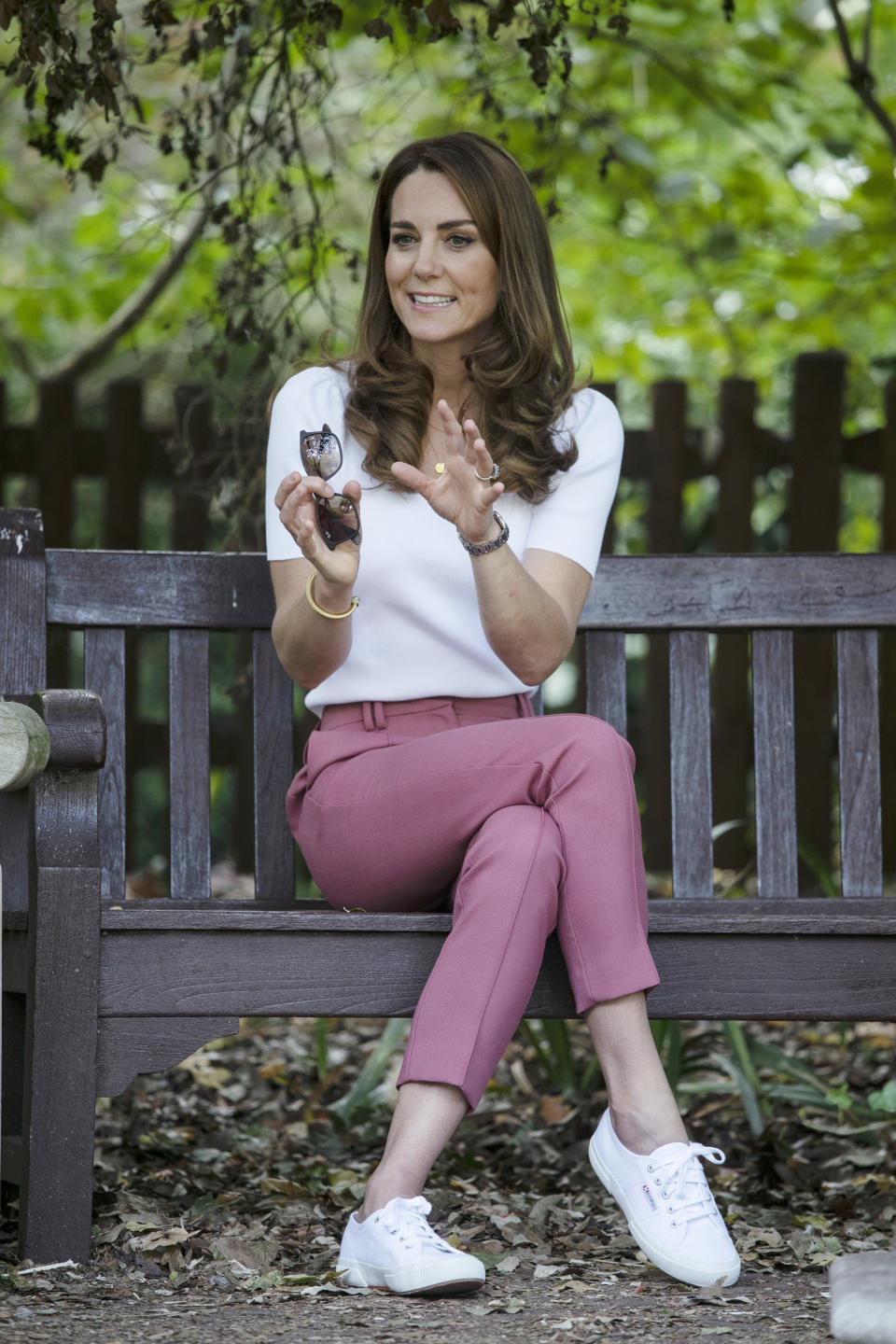 The Duchess of Cambridge wore M&S pink trousers and Superga trainers when she met families and key organisations to discuss how peer support can help boost parent wellbeing at London's Battersea Park in September 2020.  (Getty Images)
