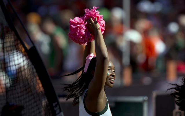 A Miami Hurricanes cheerleader celebrates Breast Cancer Awareness Month during the first half of an NCAA college football game in Miami Gardens, Fla., Saturday, Oct. 5, 2013, against Georgia Tech. (AP Photo/J Pat Carter)