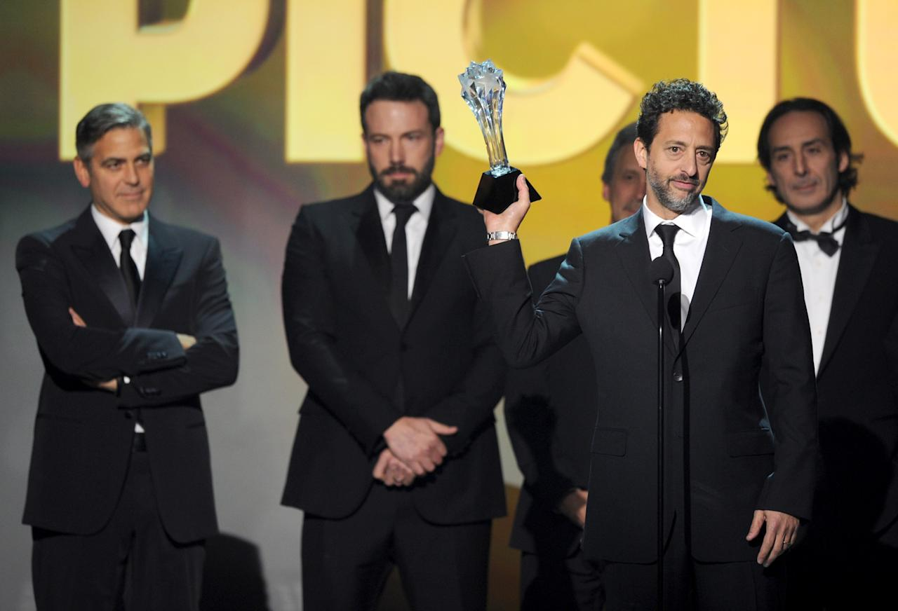 "SANTA MONICA, CA - JANUARY 10:  (L-R) Producer George Clooney, Actor/Producer/Director Ben Affleck, Producer Grant Heslov and Composer Alexandre Desplat accept the Best Picture Award for ""Argo"" onstage at the 18th Annual Critics' Choice Movie Awards held at Barker Hangar on January 10, 2013 in Santa Monica, California.  (Photo by Kevin Winter/Getty Images)"