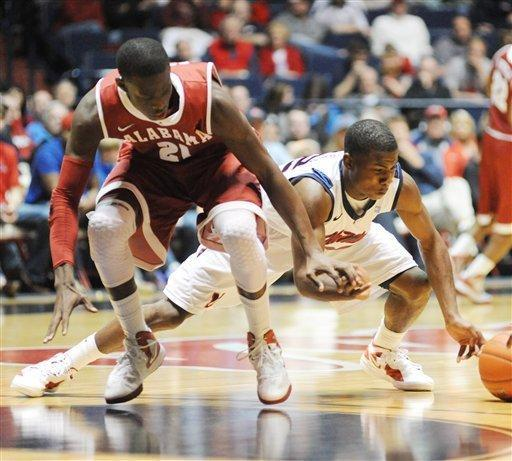 Mississippi's Jarvis Summers (32) and Alabama's Rodney Cooper (21) go for the ball during an NCAA college basketball game in Oxford, Miss. on Saturday, March 3, 2012. (AP Photo/Oxford Eagle, Bruce Newman) MAGS OUT NO SALES MANDATORY CREDIT