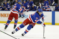 New York Rangers left wing Artemi Panarin (10) skates with the puck as Rangers defenseman Brendan Smith (42) watches, left, during the second period of an NHL hockey game, Sunday, Jan. 19, 2020, in New York. (AP Photo/Kathy Willens)