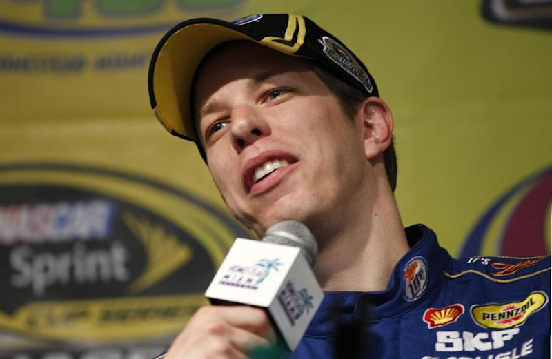 Driver Brad Keselowski smiles during a news conference following practice for Sunday's NASCAR Sprint Cup Series auto race at Homestead-Miami Speedway, Saturday, Nov. 17, 2012, in Homestead, Fla. The final Sprint Cup series race will take place Sunday. (AP Photo/J Pat Carter)