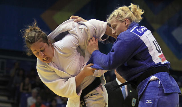 Kayla Harrison of the U.S. (blue) battles Catherine Roberge of Canada to win the gold medal in the women's -78kg judo contest at the Pan American Games in Guadalajara October 27,2011. REUTERS/Mariana Bazo (MEXICO - Tags: SPORT JUDO)