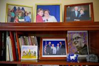 Pictures show local county official Evie Rafalko-McNulty with Barack Obama and Bill and Hillary Clinton