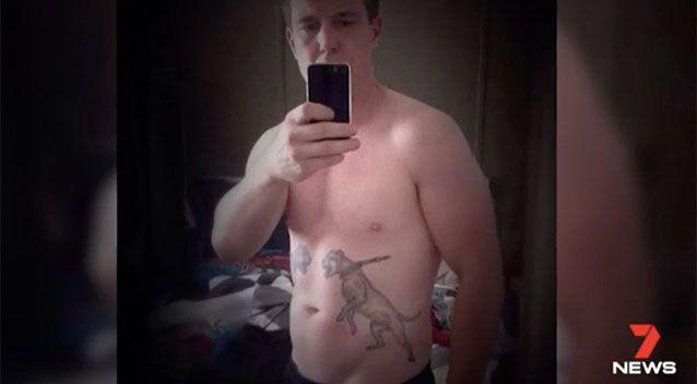 Benn Hamilton showing off his dog fighting tattoos. Source: 7 News