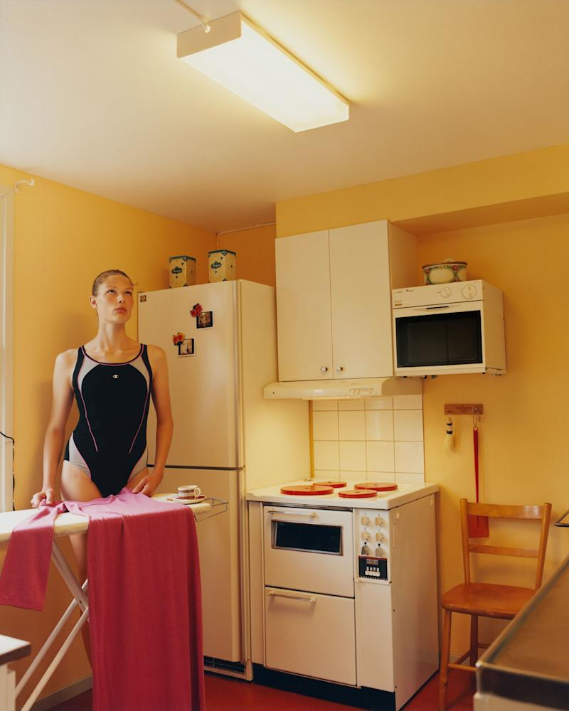 Adela ironing the Isabel Marant dress in our dream kitchen of the cabin.