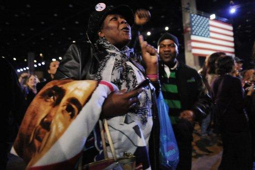 US President Barack Obama supporter Dina Rutledge celebrates as she watches voting results on election night in Chicago, Illinois. Obama took two big strides towards re-election Tuesday by blocking Mitt Romney's grab for Pennsylvania and Wisconsin, the first key states called in their bitter White House race