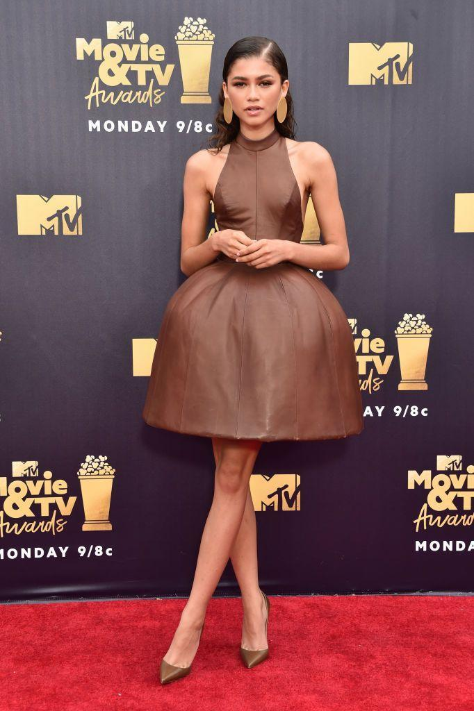 <p>Zendaya opted for a August Getty brown leather mini dress. </p>