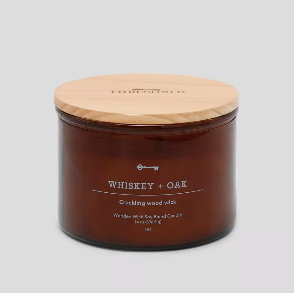 <p>ICYMI, delicious candles are practically synonymous with fall. For a flame that can appeal to all of the senses, reach for this <span>Threshold Whiskey &amp; Oak Crackling Candle</span> ($18). Not only does this pick have handsome notes like oak and whiskey, but it also boasts a crackling wick that sounds just like a roaring fire.</p>
