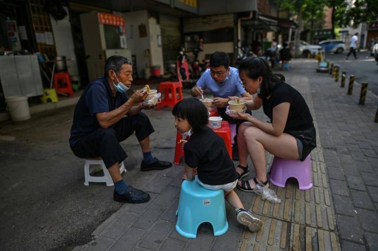 With births in China expected to decline further, the country could scrap punishments for having three or more children (AFP Photo/Hector RETAMAL)