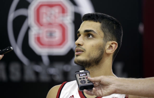 "North Carolina State's <a class=""link rapid-noclick-resp"" href=""/ncaab/players/136051/"" data-ylk=""slk:Omer Yurtseven"">Omer Yurtseven</a> takes questions during the NCAA college basketball team's media day in Raleigh, N.C., Tuesday, Sept. 26, 2017. (AP Photo/Gerry Broome)"