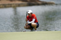 Giulia Molinaro of Italy studies her putt on the 18th hole, during the third round of play in the KPMG Women's PGA Championship golf tournament, Saturday, June 26, 2021, in Johns Creek, Ga. (AP Photo/John Bazemore)
