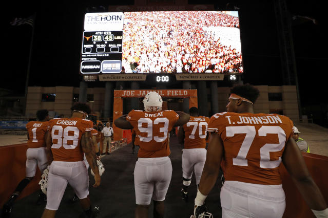 Texas Longhorns players walk off the field after the game with the LSU Tigers Saturday Sept. 7, 2019 at Darrell K Royal-Texas Memorial Stadium in Austin, Tx. LSU won 45-38. ( Photo by Edward A. Ornelas )