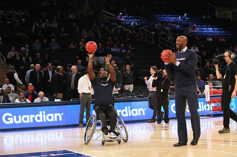 Hall of Fame center Alonzo Mourning plays a game of HORSE with wheelchair basketball star Chris Saint-Remy during the 2K Empire Classic at Madison Square Garden. (Stuart Ramson/AP Images for Guardian Life Insurance)