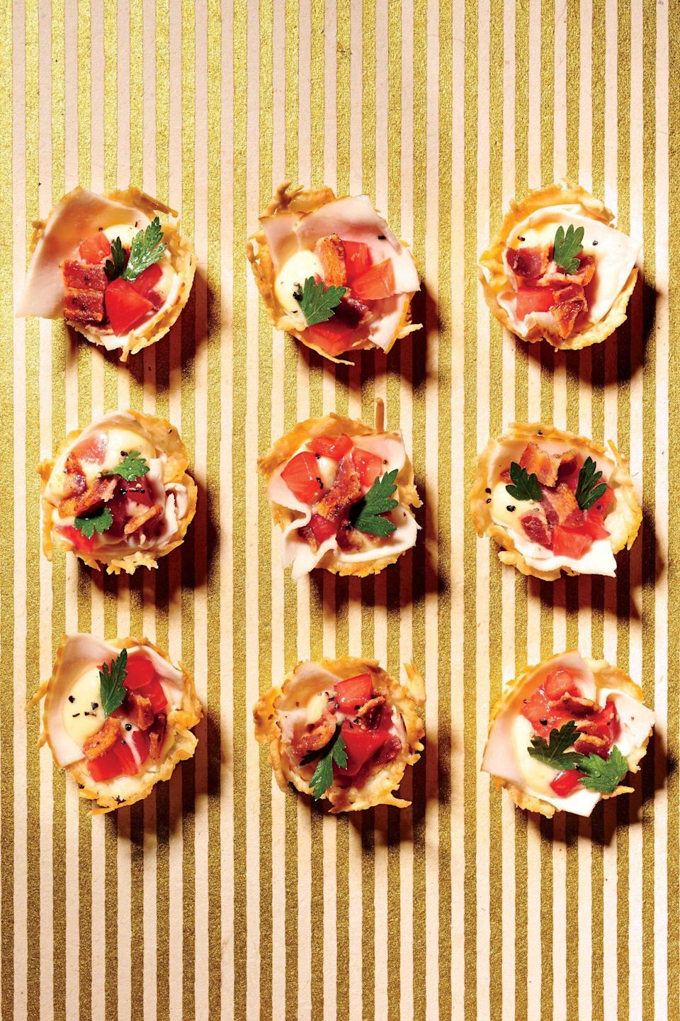 """<p><strong>Recipe: <a href=""""https://www.southernliving.com/syndication/inside-out-hot-brown-bites"""" rel=""""nofollow noopener"""" target=""""_blank"""" data-ylk=""""slk:Inside-Out Hot Brown Bites"""" class=""""link rapid-noclick-resp"""">Inside-Out Hot Brown Bites</a></strong></p> <p>This recipes proves that Kentucky's signature sandwich can be enjoyed in bite-size form. </p>"""