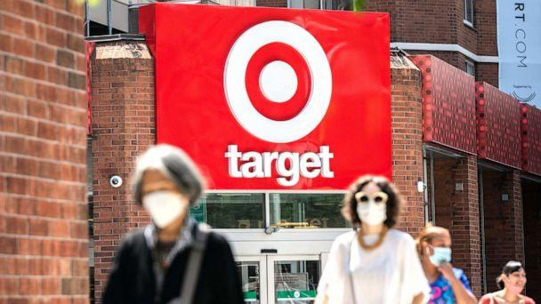 PHOTO: In this Aug. 17, 2020, file photo, pedestrians wearing protective masks walk past a Target store in New York. (Jeenah Moon/Bloomberg via Getty Images, FILE)