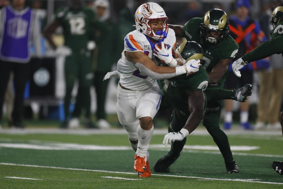 Boise State running back George Holani (24) runs in the second half of an NCAA college football game againsy Colorado State, Friday, Nov. 29, 2019, in Fort Collins, Colo. Holani was the Mountain West freshman of the year last season after rushing for 1,014 yards and seven touchdowns. (AP Photo/David Zalubowski)