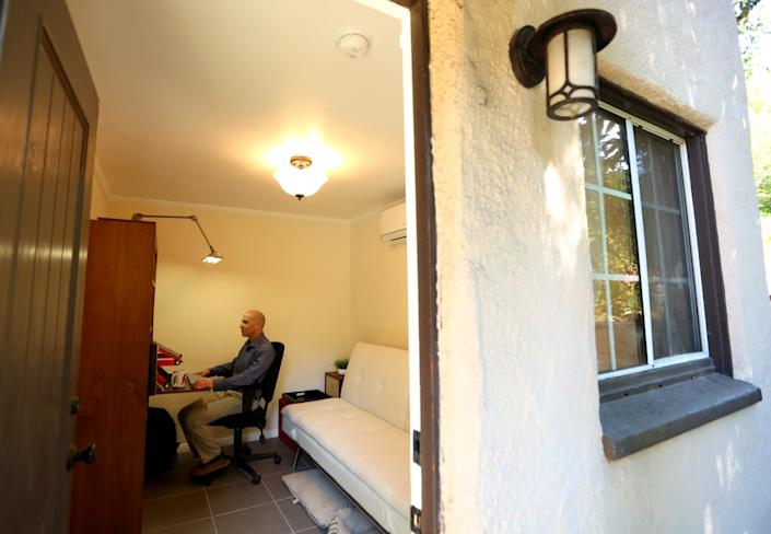 Dr. Steven Siegel works in his office at home in Glendale.