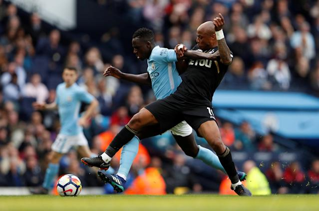 "Soccer Football - Premier League - Manchester City v Swansea City - Etihad Stadium, Manchester, Britain - April 22, 2018 Manchester City's Benjamin Mendy in action with Swansea City's Andre Ayew Action Images via Reuters/Lee Smith EDITORIAL USE ONLY. No use with unauthorized audio, video, data, fixture lists, club/league logos or ""live"" services. Online in-match use limited to 75 images, no video emulation. No use in betting, games or single club/league/player publications. Please contact your account representative for further details."