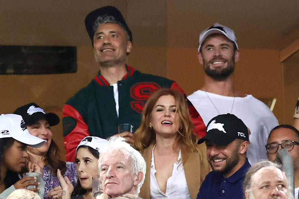 <p>Taika Waititi, Isla Fisher, Chris Hemsworth and wife Elsa Pataky (not pictured) and Russell Crowe (bottom right) gather at the round three National Rugby League match between the South Sydney Rabbitohs and the Sydney Roosters on Friday in Sydney, Australia. </p>