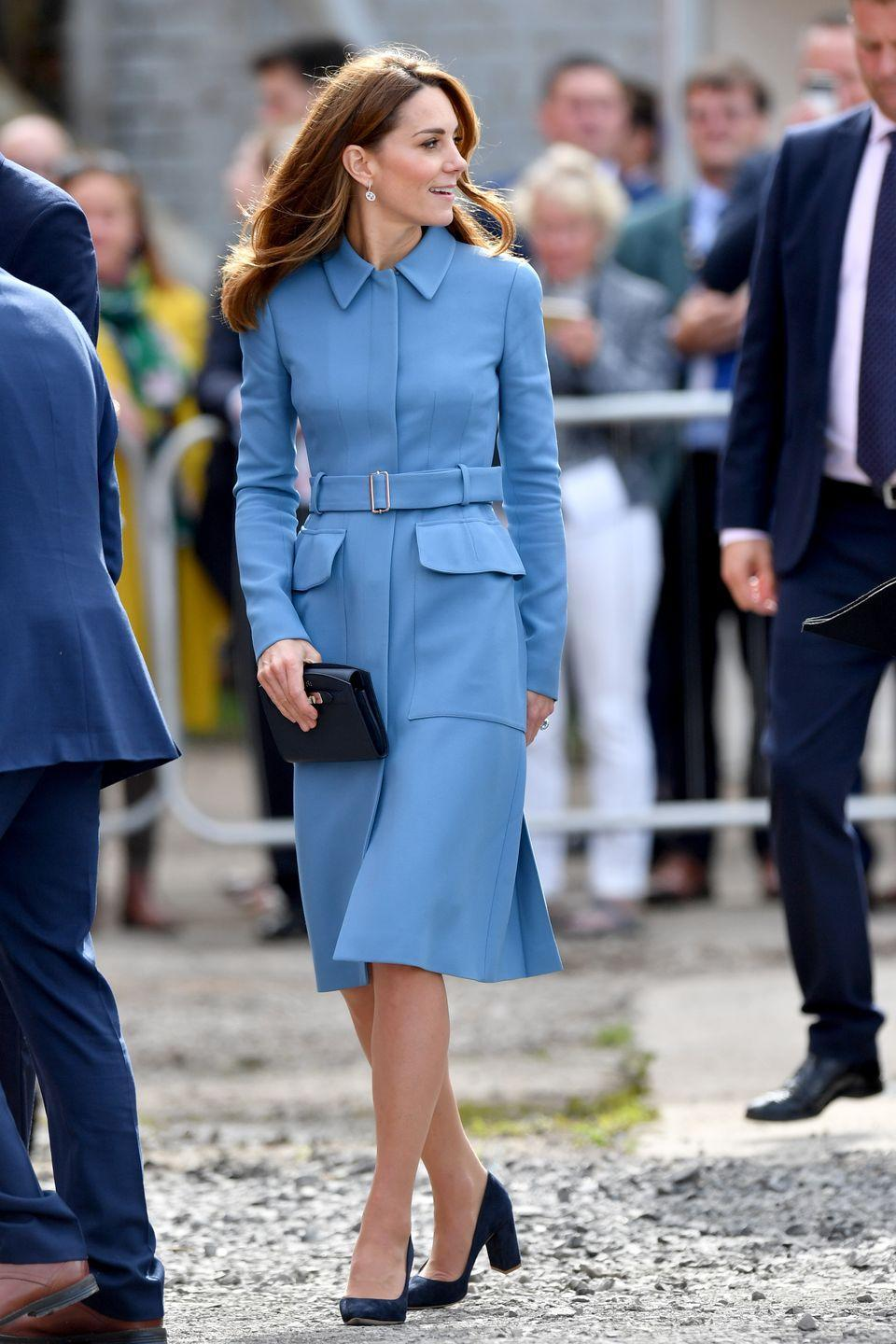 """<p>Kate often rewears this powder blue, belted McQueen coat, featuring large pockets. She chose the outerwear here for the naming ceremony for the boat, the RSS Sir David Attenborough. She also <a href=""""https://www.townandcountrymag.com/style/fashion-trends/a29243564/kate-middleton-alexander-mcqueen-coat-david-attenborough-ship-naming-photos/"""" rel=""""nofollow noopener"""" target=""""_blank"""" data-ylk=""""slk:previously wore this coat in 2014 and in 2016"""" class=""""link rapid-noclick-resp"""">previously wore this coat in 2014 and in 2016</a>.</p>"""