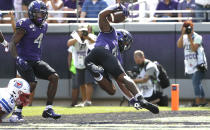 TCU running back Darius Anderson (6) runs for a touchdown as SMU safety Trevor Denbow (16) looks on during the first half of an NCAA college football game Saturday, Sept. 21, 2019, in Fort Worth, Texas. (AP Photo/Ron Jenkins)